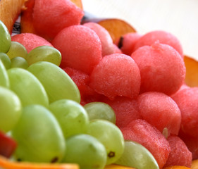 Water melons scoops and grapes