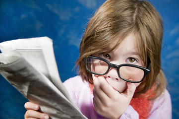Girl with Glasses and a Newspaper