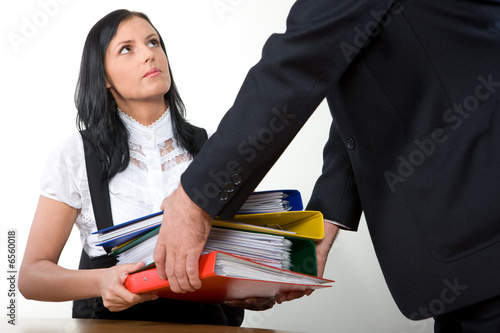 a boss gives more work to an assistant