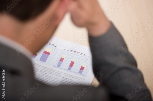 man reading financial newspaper