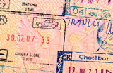 Stamps in foreign passport closeup poster