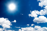 Dramatic high contrast blue sky with sun poster