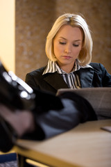 Young  beautiful business woman reading2