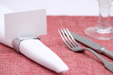 blank place card on a napkin ring