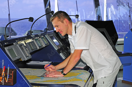 poster of Navigation officer works with a navigation chart