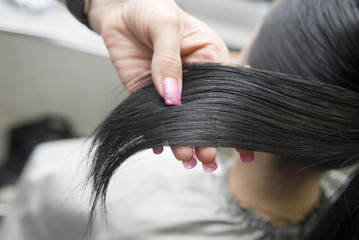 Comb one's black hair
