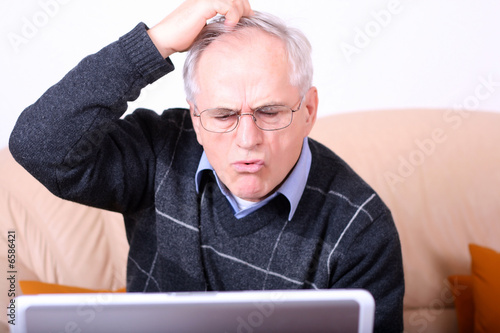 Senior man with a computer problem