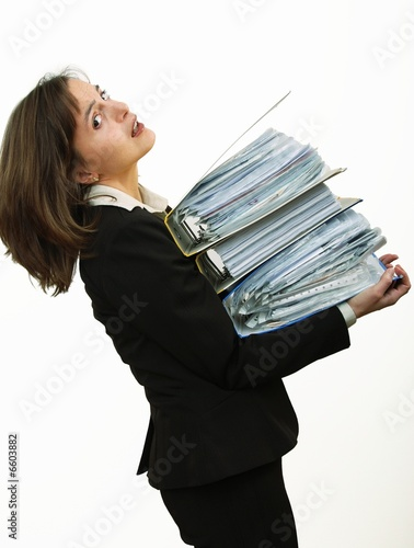 Business woman overloaded with files