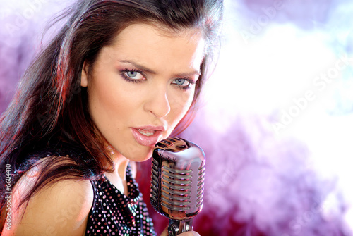 Rock star. Sexy Girl singing with retro mic - 6604410