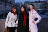 Three young girls in a twilight city. St. Petersburg, Russia. poster