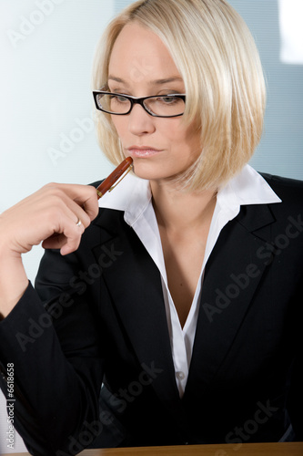 a businesswoman thinking
