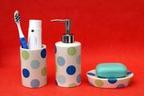 tablet of soap on dish. bottle for soap. toothpaste & toothbrush poster
