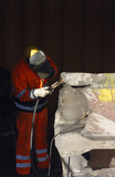 industrial welder against black backdrop poster