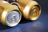 silver and gold aluminum drink can on the dark blue background poster