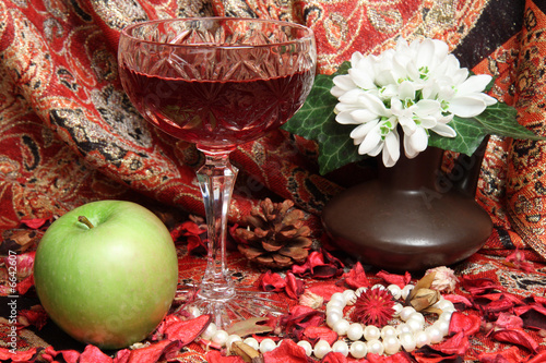 Still life with wine, apple and flowers