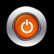 Orange power button over black background