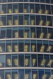 Illuminated office windows poster
