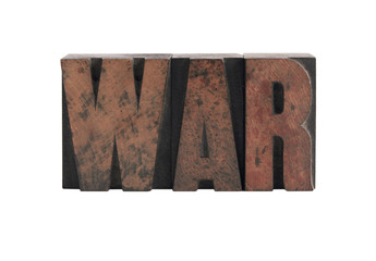 the word 'war' in ink-stained wood letters