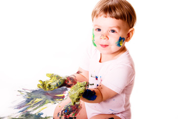 Young painter with dirty hands