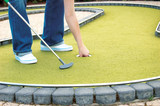 playing minigolf