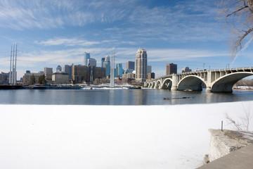 Urban Minneapolis across icy river