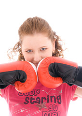 The young beautiful girl with boxing gloves isolated on a white