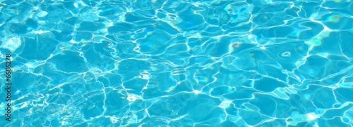 Aquamarine blue pool water sparkling clean  - 6686278