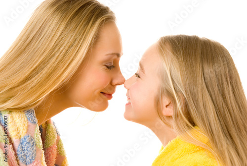 Mother and daughter close-up portrait isolated over white backgr