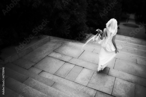 A bride walking away down a staircase