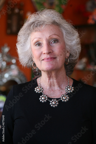 Mature woman with grey hair and beautiful silver jewelry