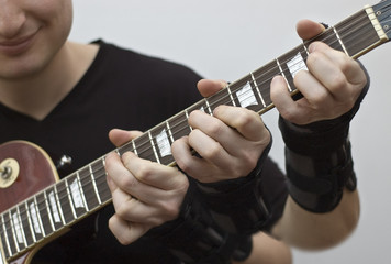 Triple action on a guitar fretboard