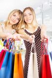 Two girls with bags - comparison shopping. Sale! poster