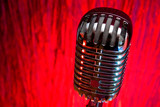 retro microphone over red background