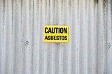 Sign with text CAUTION ASBESTOS poster