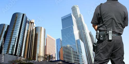 Leinwanddruck Bild Security agent watching downtown area