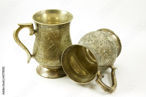Two ancient silver tankards