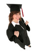 Woman in graduation robes clenching fists