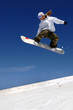 woman snowboarder in flight with sky behind