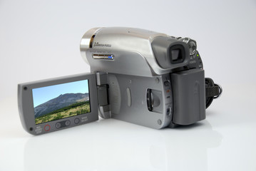 the silver modern camera of the video