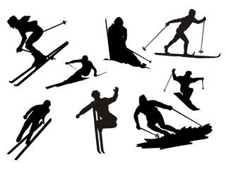 silhueta de esquiadores