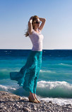 Slim woman enjoy warm sea wind poster