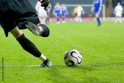 Soccer or football goalkeeper kick the ball