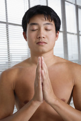 Close up of a young man in meditation.