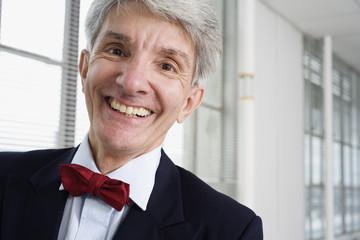 Portrait of a mature man smiling.
