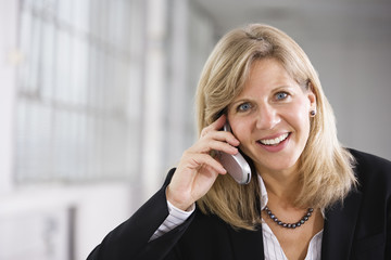 Portrait of a  business woman using a cellphone.
