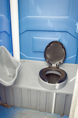 A commode in a camping toilet.