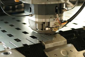 Programmable punching machine, close up