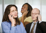 Three Businesspeople on Cell Phones poster