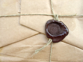 brown packet with sealing wax