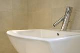Closeup of contemporary hand-basin and tap poster